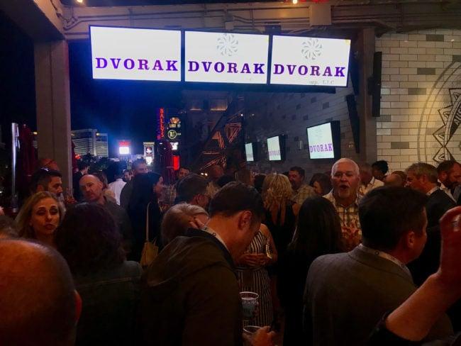 screens at conference showing Dvorak logo